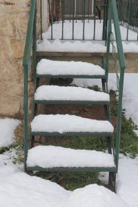 My landlord did not clear snow or ice from a staircase and I fell